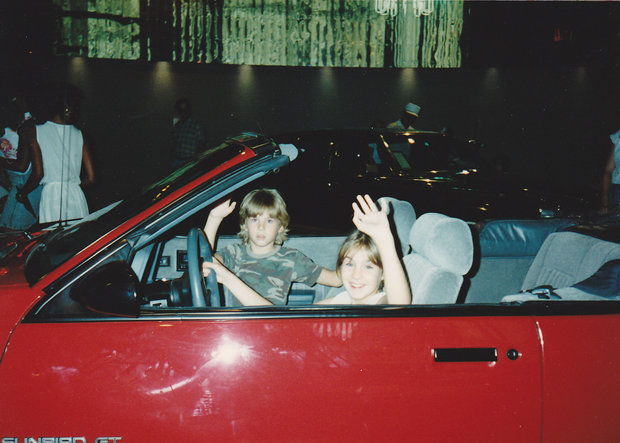 Me and my sister at World of Motion's Trans Center in a red Sunfire GT circa 1986.