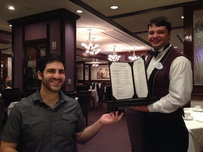 Our host hands Nick a menu