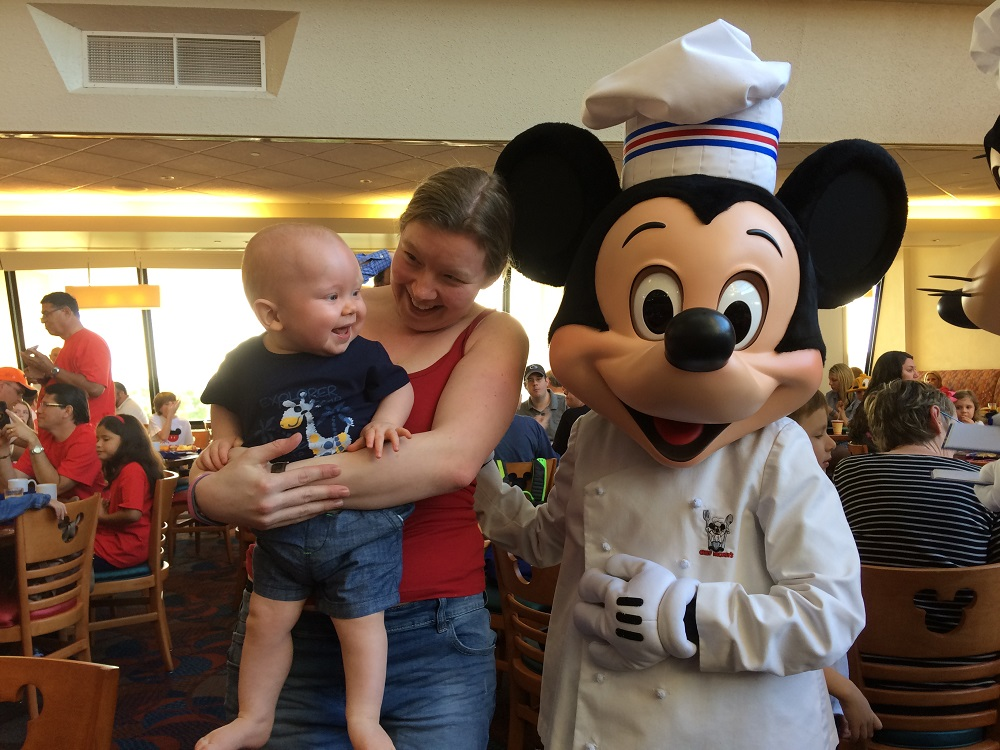 Our Little Boy meeting Mickey Mouse at Chef Mickeys, The Contemporary