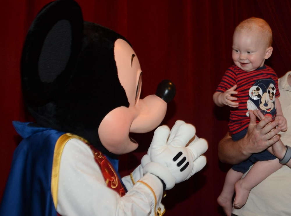 Elliot meeting Mickey Mouse at the Town Square Theatre Magic Kingdom