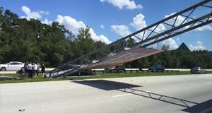 Walt Disney World directional sign falls on road sign after being hit by SUV
