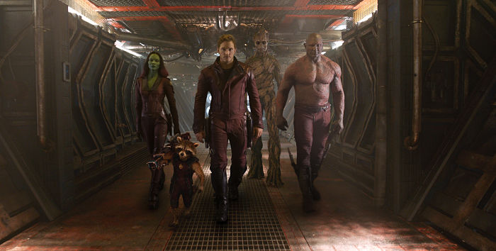 "Gamora (Zoe Saldana), left, Rocket Racoon (voiced by Bradley Cooper), Peter Quill/Star-Lord (Chris Pratt), Groot (voiced by Vin Diesel) and Drax the Destroyer (Dave Bautista) in a scene from the motion picture ""Guardians of the Galaxy."" CREDIT: Marvel [Via MerlinFTP Drop]"