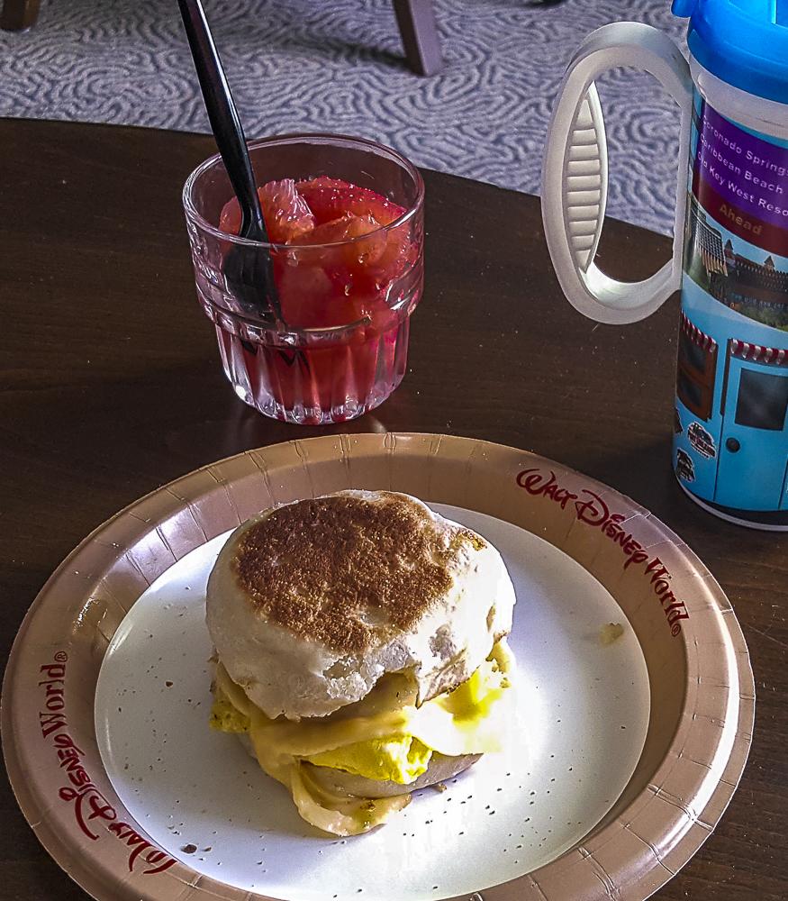 Breakfast, egg sandwich and grapefruit.