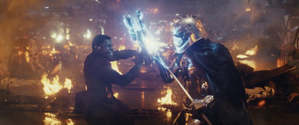 Star Wars: The Last Jedi L to R: Finn (John Boyega) battling Captain Phasma (Gwendoline Christie) Photo: Lucasfilm Ltd. © 2017 Lucasfilm Ltd. All Rights Reserved.