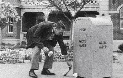 Walt Picking Up Trash with Trash Bin