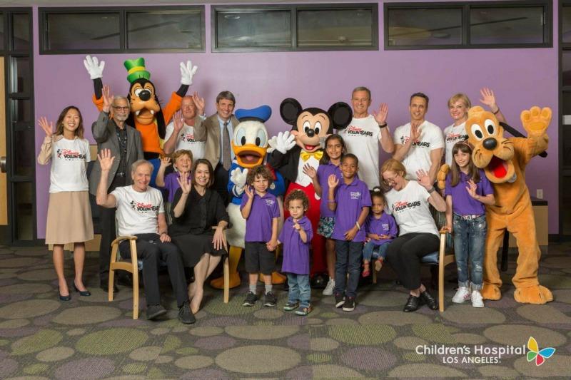 Disney VoluntEARS with Mickey Pluto