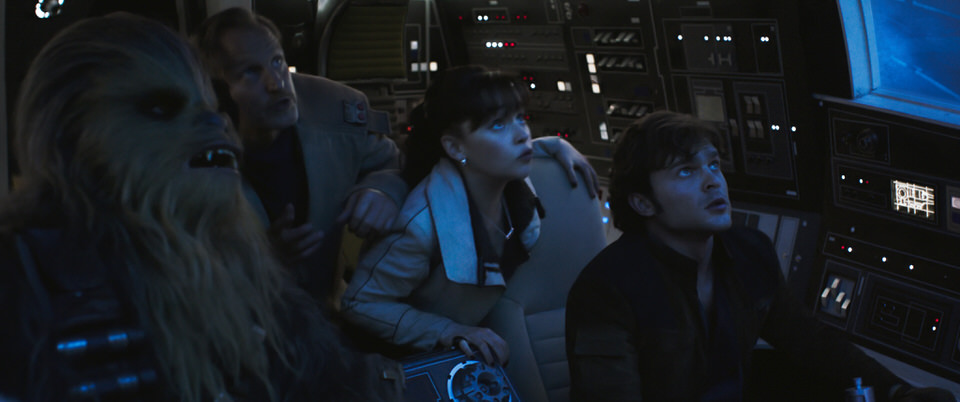 Joonas Suotamo is Chewbacca, Woody Harrelson is Beckett, Emilia Clarke is Qi'ra and Alden Ehrenreich is Han Solo in SOLO: A STAR WARS STORY.