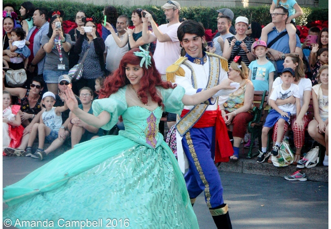 "Ariel and Eric dancing in Disneyland Resort's ""A Christmas Fantasy"" Parade"