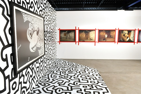 NEW YORK, NY - NOVEMBER 06: Art by Kieth Haring and Tseng Kwong Chi. Mickey: The True Original Exhibition celebrates 90 years of Mickey Mouse's influence on art and pop culture. Opening November 8, 2018 through February 10, 2019, this immersive experience is inspired by Mickey's status as a 'true original' and his consistent impact on the arts and creativity in all its forms. Guests will have the chance to explore the 16,000 square-foot exhibition featuring both historic and contemporary work from renowned artists. The exclusive pop-up retail shop carries special merchandise and offers customization. (Photo by Craig Barritt/Getty Images for Disney)