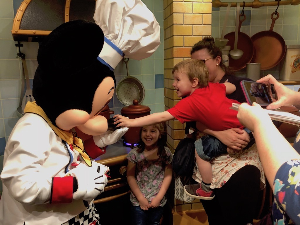 One should never honk Mickey Mouse's nose. But Simon was so overcome with joy that I think even Mickey understood.