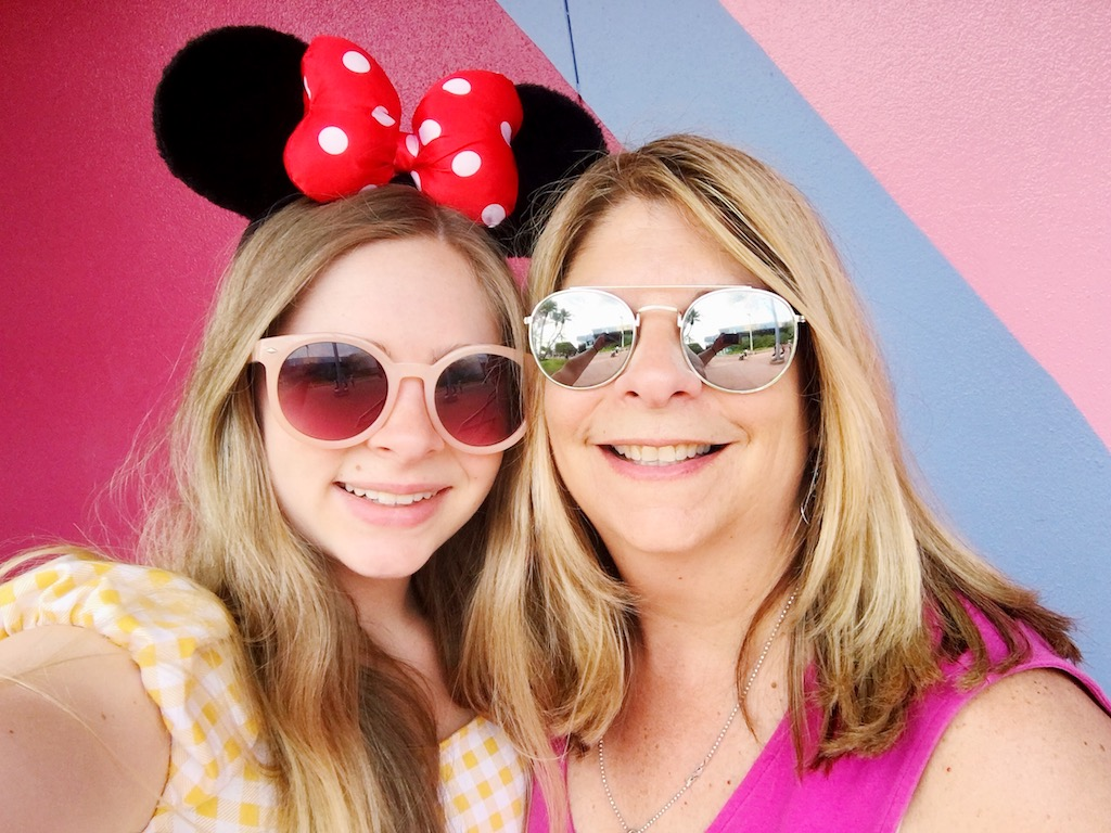 My mom and I at the bubblegum wall in Epcot a mere 16 hours after the breakup.