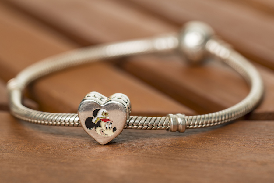 To celebrate the excitement of Captain Minnie Mouse at the helm, Disney Cruise Line unveiled a new PANDORA Jewelry charm available for purchase exclusively aboard Disney ships. The debut of Captain Minnie Mouse is part of a collection of new initiatives aiming to inspire the next generation of female leaders in the maritime industry. (Matt Stroshane, photographer)
