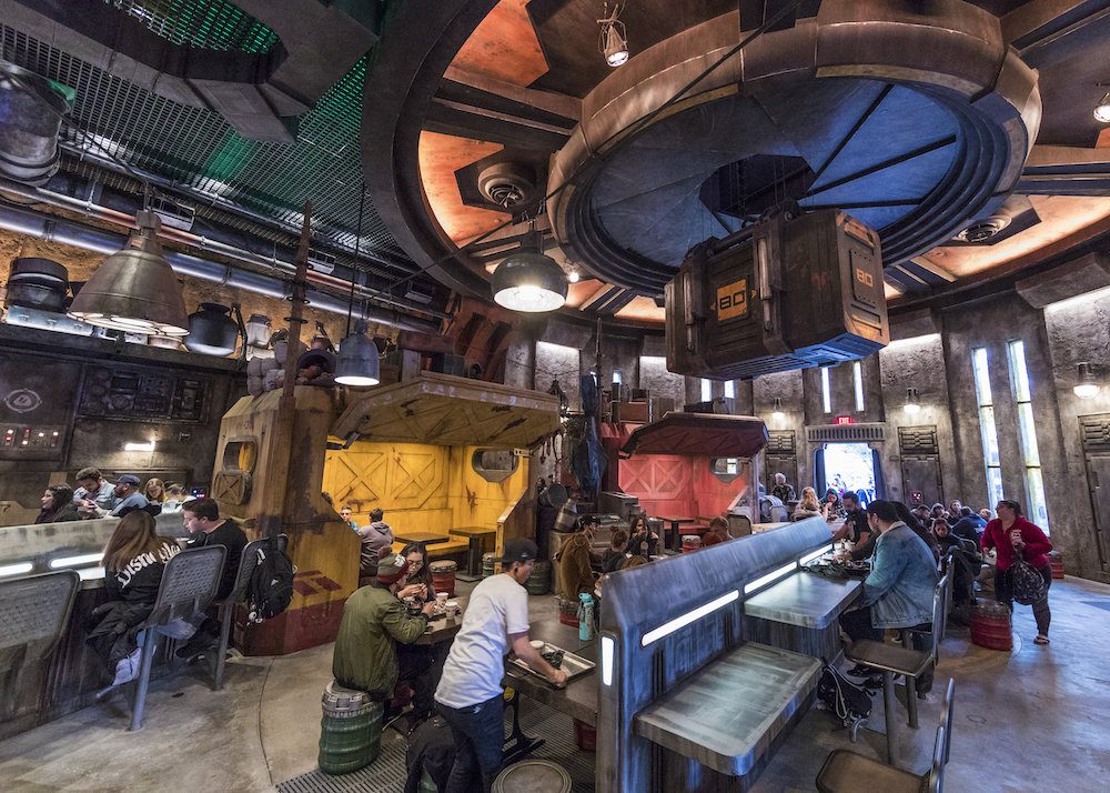 "Guests will discover innovative and creative eats from around the galaxy at Star Wars: Galaxy's Edge at Disneyland Park in Anaheim, California, and at Disney's Hollywood Studios in Lake Buena Vista, Florida. Docking Bay 7 Food and Cargo is a designated location for traveling food shuttles. Chef Strono ""Cookie"" Tuggs is in much demand for his culinary skills, so he moves from site to site in a modified Sienar-Chall Utilipede-Transport that becomes a mobile kitchen and restaurant. (Joshua Sudock/Disney Parks)"