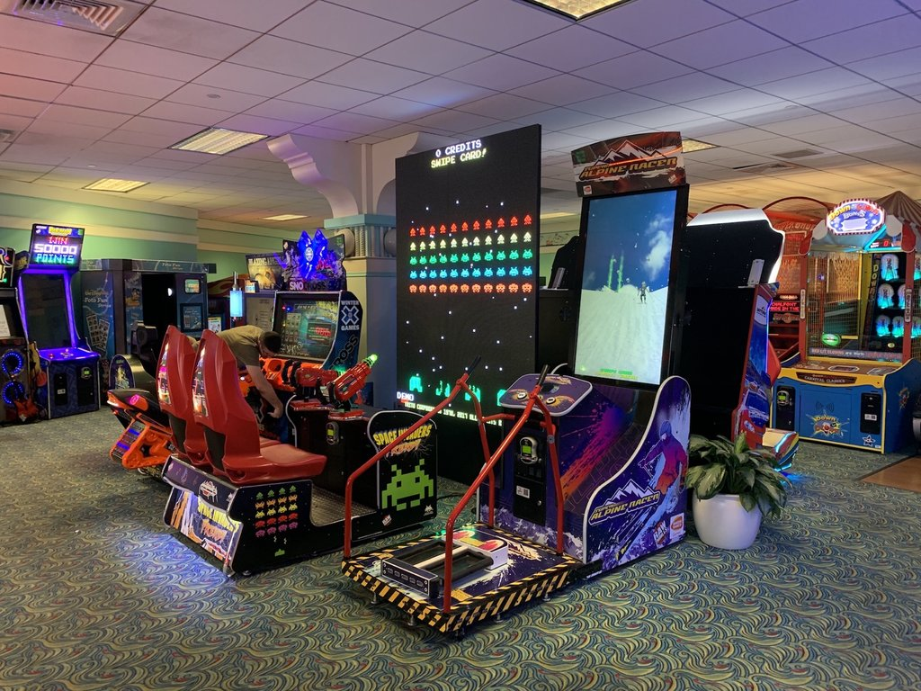 Disney's Yacht Club arcade is big enough to entertain all gamers and has a few comfy spots for non-gamers to relax. Photo: The Dis
