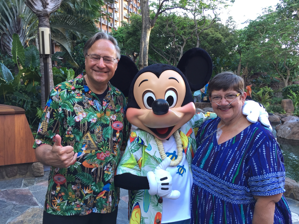 Michael & Carol with MIckey atAulani
