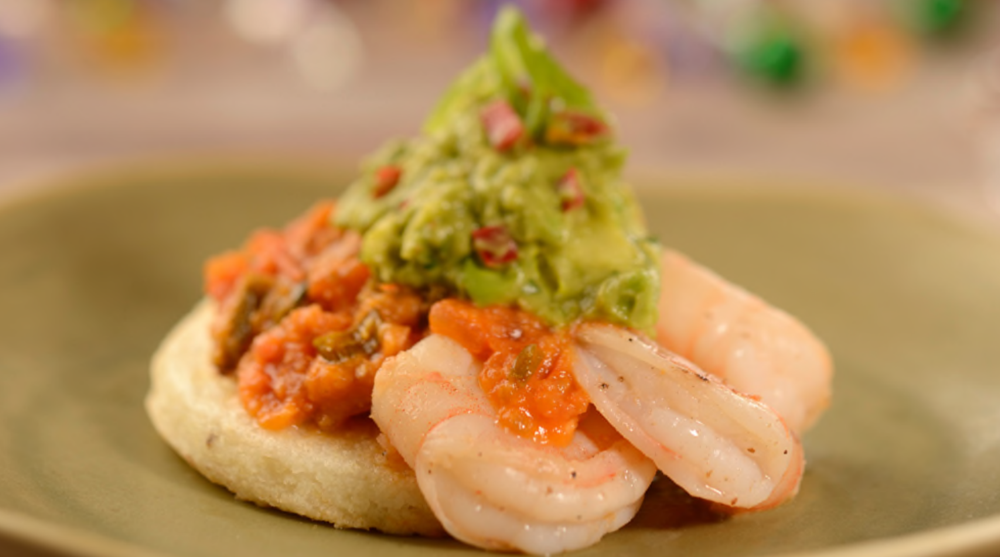 Queso Fresco-stuffed Arepa topped with Shrimp, Crushed Avocado Aji and Tomato Sauce