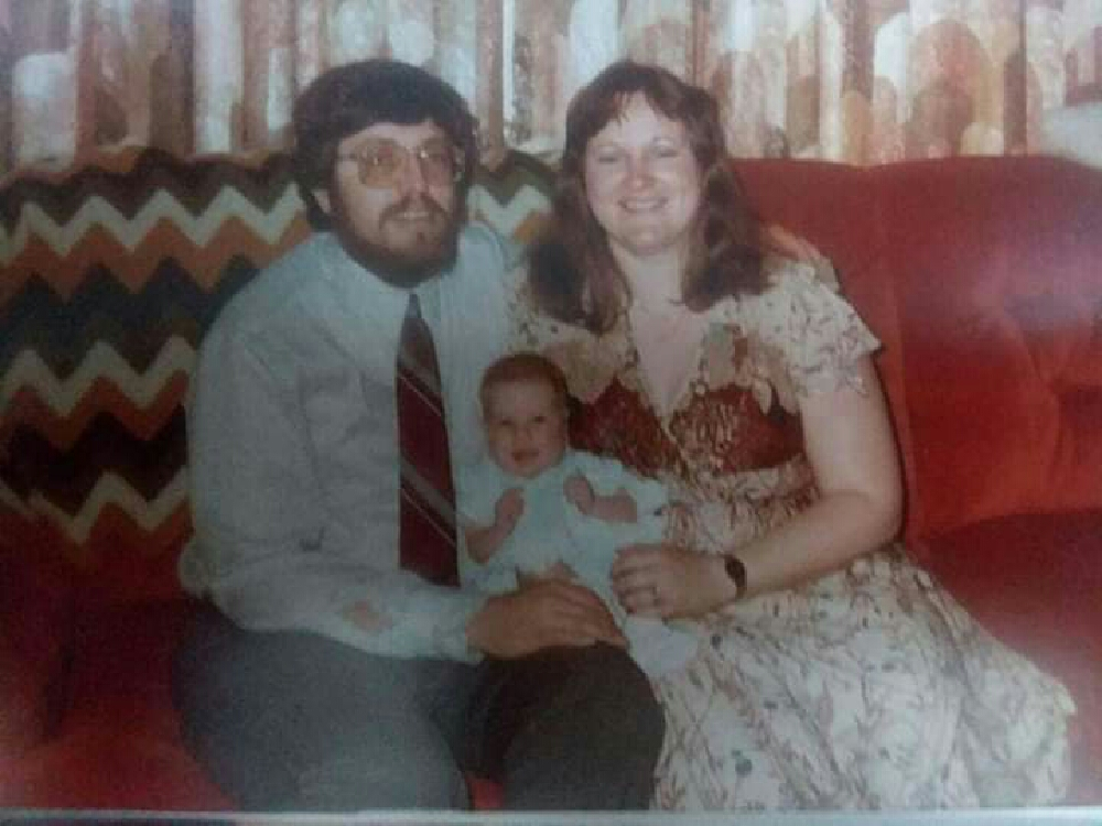 The photo that is in the frame I gave my father, or odds of course my Dad, Mom, and I. I'd say probably 1983.