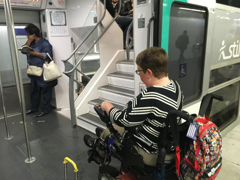 Author boarding train to DisneyLand Paris in motorized wheelchair