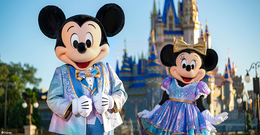 Mickey and Minnie Mouse standing in front of Cinderella Castle